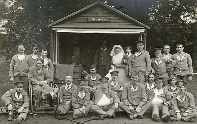 "Gledhow Hall Military Hospital, Edith Cliff and patients outside ""Blighty"" Hut"